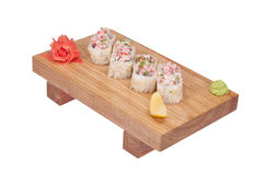 Sushi rolls on wood stand Stock Images