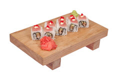 Sushi rolls on wood stand Royalty Free Stock Photo