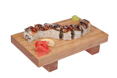 Sushi rolls on wood stand Stock Photography