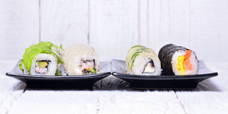 Sushi rolls on wooden background Royalty Free Stock Image