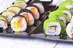 Sushi rolls on wooden background Stock Photo