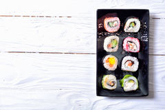 Sushi rolls on wooden background Stock Photography