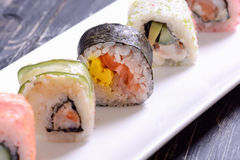 Sushi rolls on wooden background Royalty Free Stock Photo