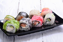 Sushi rolls on wooden background Stock Photos