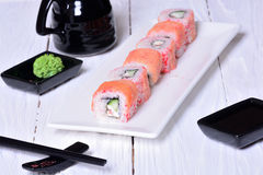 Sushi rolls on wooden background Royalty Free Stock Photos