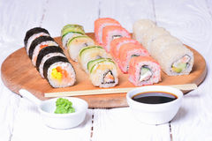 Sushi rolls on wooden background Royalty Free Stock Photography