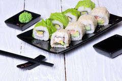 Sushi rolls on wooden background Stock Images