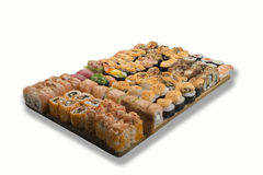 Sushi and rolls on a wooden board royalty free stock photo