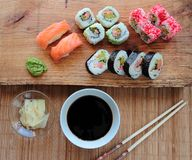 Sushi rolls on wooden desk Stock Image