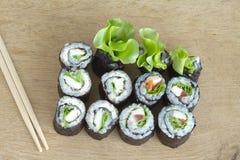 Sushi rolls on wooden desk Stock Photo