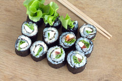 Sushi rolls on wooden desk Royalty Free Stock Images