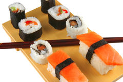 Sushi rolls on wooden plate Royalty Free Stock Photography