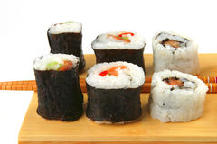 Sushi rolls on wooden plate Stock Photo
