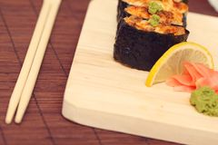 Sushi and rolls on the wooden plate Stock Images