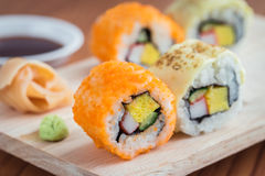 Sushi rolls on wooden plate Stock Image