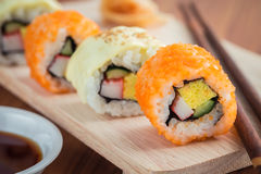 Sushi rolls on wooden plate Stock Photos