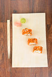 Sushi rolls on the wooden plate. Top view. Stock Image