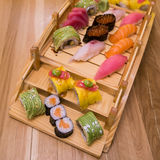 Sushi rolls wooden plate Royalty Free Stock Photography