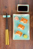 Sushi rolls on the wooden table. Aerial view. Royalty Free Stock Photos
