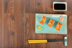 Sushi rolls on the wooden table. Overhead view Royalty Free Stock Image