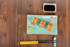 Sushi rolls on the wooden table. Overhead view Stock Photo
