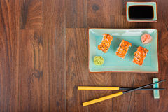 Sushi rolls on the wooden table. Top view. Royalty Free Stock Photography