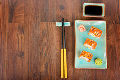 Sushi rolls on the wooden table. View from above Stock Image