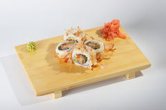 Sushi rolls on wooden tray. Details of sushi rolls on a wooden tray or cutting board Stock Image