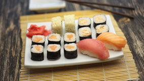 Sushi rotate on a plate. Sushi rotate on a white plate stock video footage