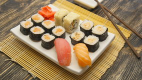 Sushi rotate on a plate. Sushi rotate on a white plate stock footage