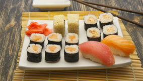 Sushi rotate on a plate. Sushi rotate on a white plate stock video