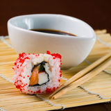 Sushi in row on bamboo mat Stock Photos