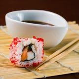 Sushi in row on bamboo mat Stock Photos