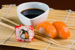 Sushi in row on bamboo mat Royalty Free Stock Photos