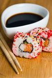 Sushi in row on bamboo mat Royalty Free Stock Images