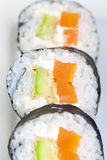 Sushi in row on white plate Stock Image