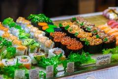 Sushi and rukkola in the shop window. Mallorca, Spain. Horizontal Royalty Free Stock Image
