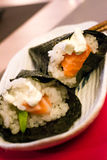 Sushi, salmon, avocado, philadephiia cheese and white rice wrapped in seaweed Stock Photo
