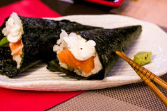 Sushi, salmon, avocado, philadephiia cheese and white rice wrapped in seaweed Stock Images