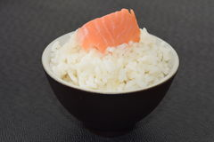 Sushi with Salmon. Sushi with Salmon in a bowl on a black background Royalty Free Stock Photography