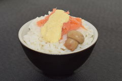 Sushi with salmon champignon and sauce. In a bowl on a black background Stock Images