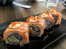 Sushi. Salmon fish dish japan rice food wood chopsticks background Stock Photography