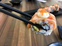 Sushi. Salmon fish dish japan rice food wood chopsticks background Royalty Free Stock Photos