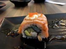 Sushi. Salmon fish dish japan rice food wood chopsticks background Royalty Free Stock Photo