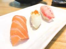 Sushi. Salmon fish dish japan rice food wood chopsticks background Royalty Free Stock Photography