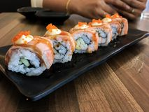 Sushi. Salmon fish dish japan rice food wood chopsticks background Stock Photo