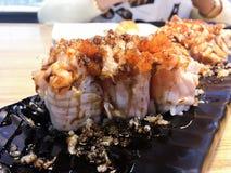 Sushi. Salmon fish dish japan rice food wood chopsticks background Royalty Free Stock Image