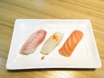 Sushi. Salmon fish dish japan rice food wood chopsticks background Stock Images