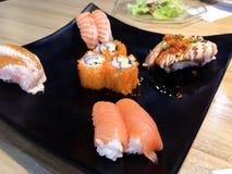 Sushi. Salmon fish dish japan rice food wood chopsticks background Stock Photos