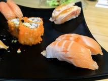 Sushi. Salmon fish dish japan rice food wood chopsticks background Stock Image